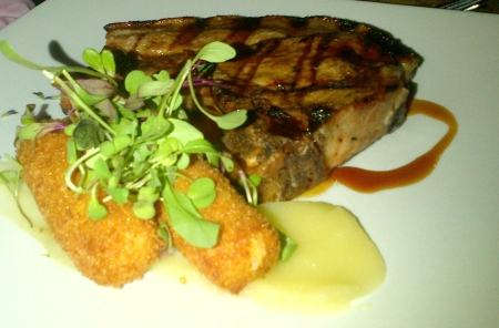 Acorn-fed pork cutlet, served with quince paste, scented pomme croquettes, apple puree and a brandy butter glaze