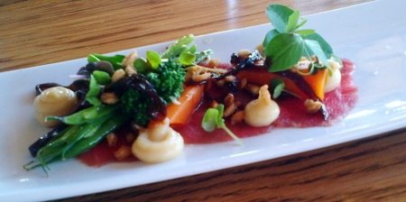 Beef carpaccio with balsamic onion, pickled vegetables and puffed barley
